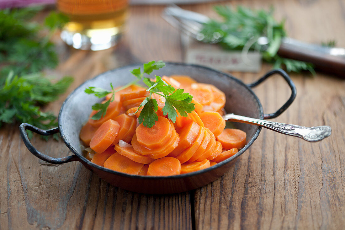 Fried carrots with shallots garnished with parsley