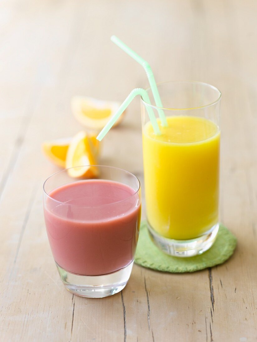 A raspberry drink and orange juice