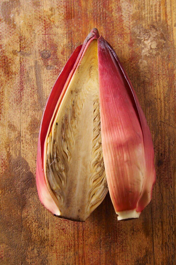 A banana flower, sliced open