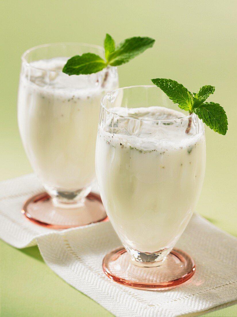 Two yogurt drinks with fresh mint
