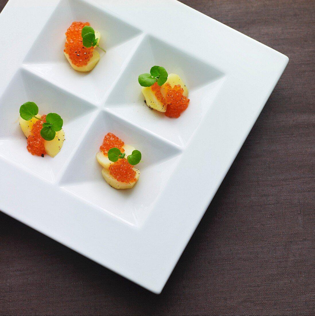 Chum salmon caviar on potato slices