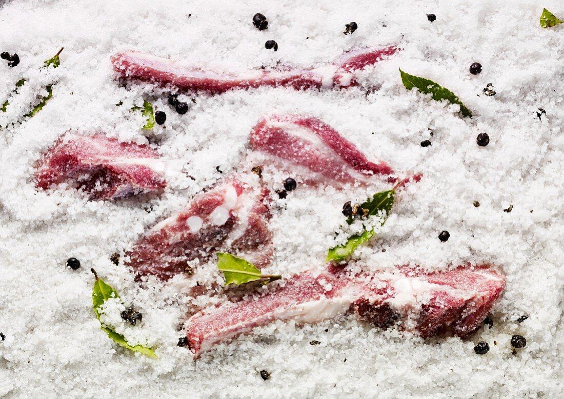 Pork in salt with bay leaves and juniper berries