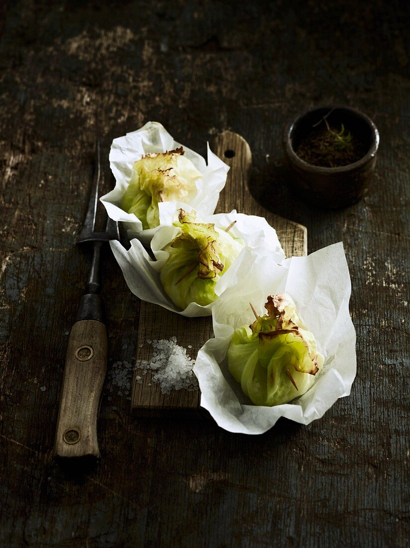 White cabbage leaves filled with fish