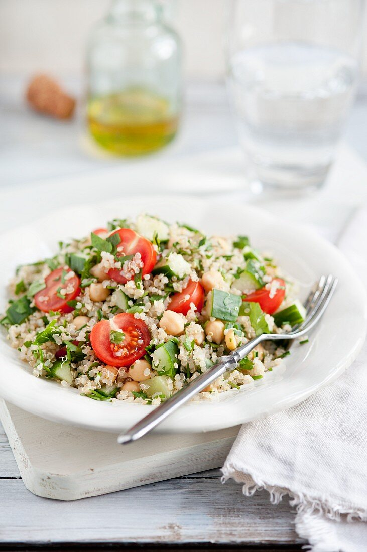 Quinoa salad with cherry tomatoes, cucumbers and chickpeas