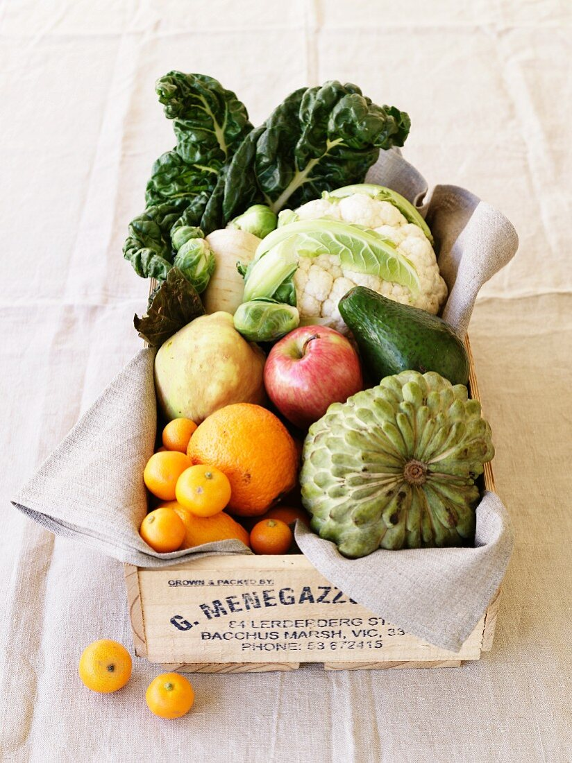 Vegetables and fruit in a wooden crate