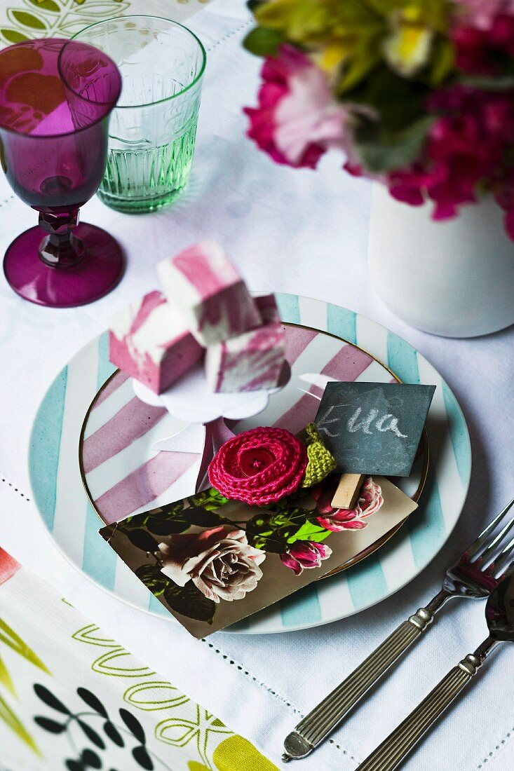 A place setting with floral cards