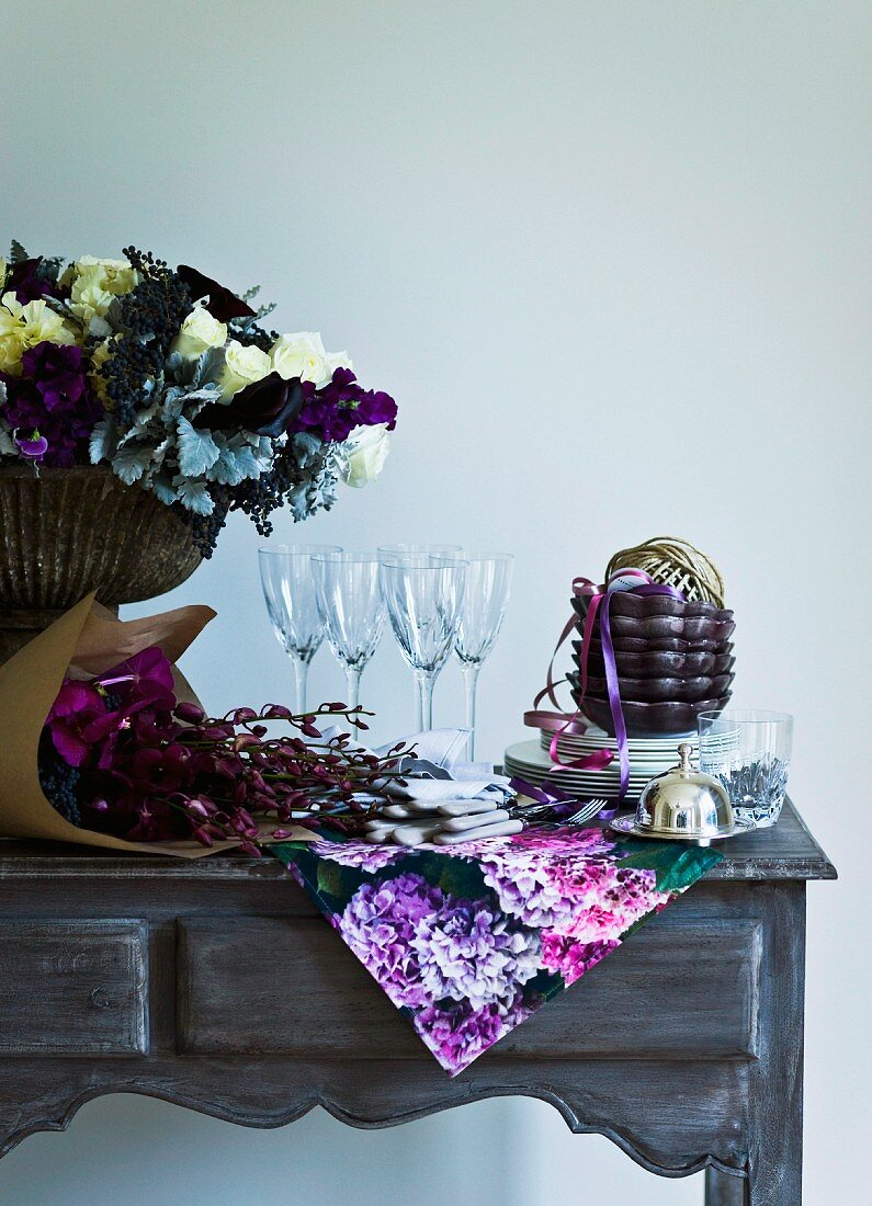 Crockery and floral decorations on a table