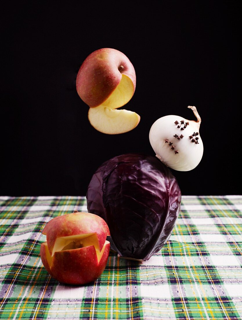 A red cabbage ghost fighting with an apple monster