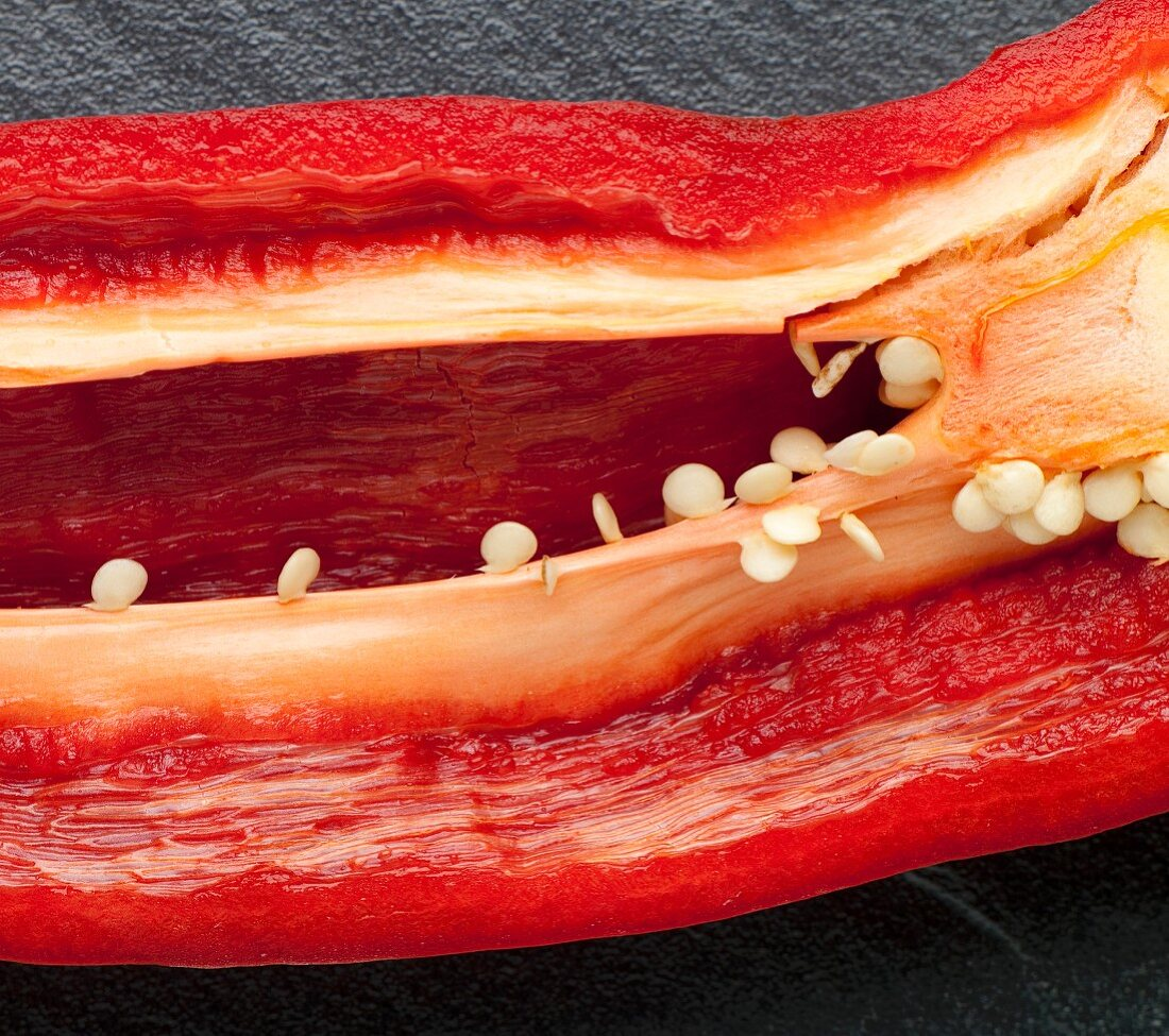 Red Pepper Sliced to Reveal Seeds and Ribs
