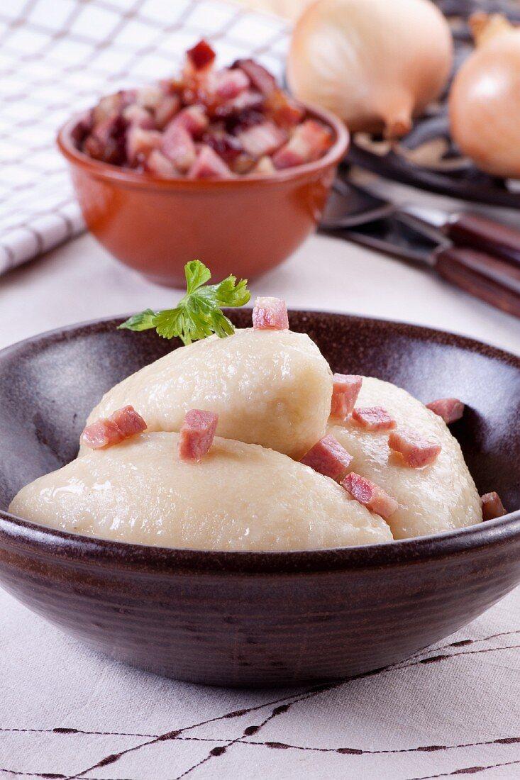 Cepelinai (Lithuanian potato dumplings filled with meat)