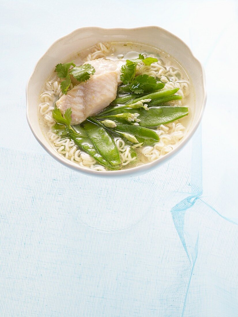 Noodle soup with sea bass and sugar snap peas