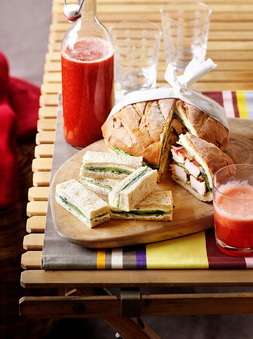 Stuffed loaf and cucumber and goats' cheese sandwiches
