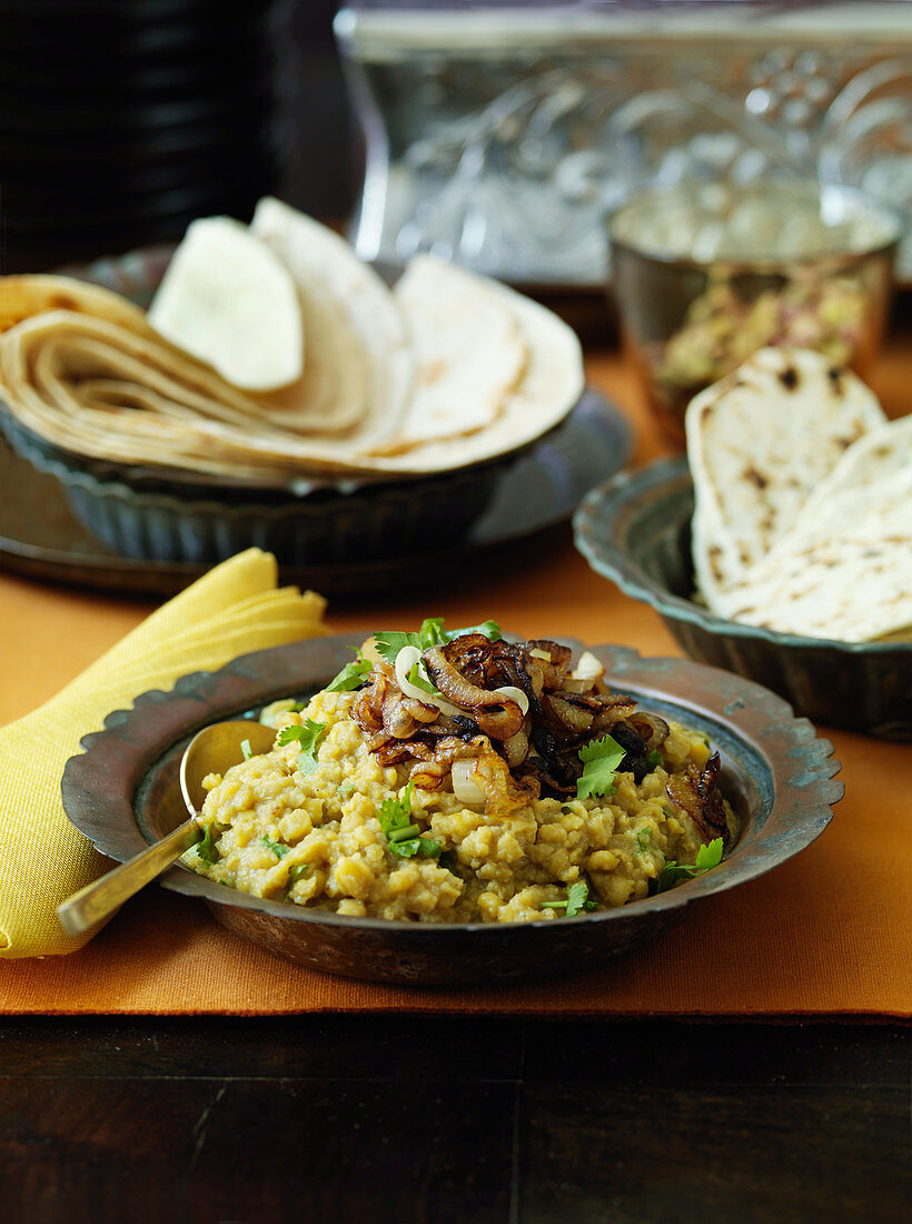 Dahl with fried onions and naan bread