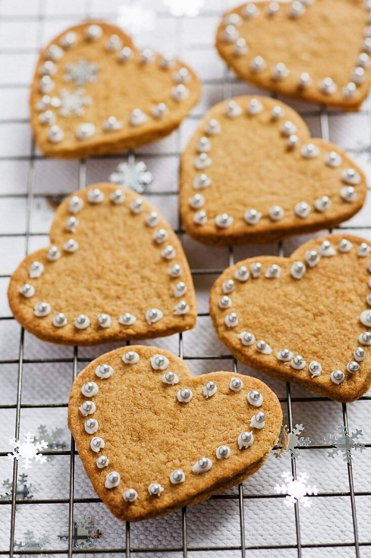 Heart-shaped cinnamon biscuits decorated with sugared beads