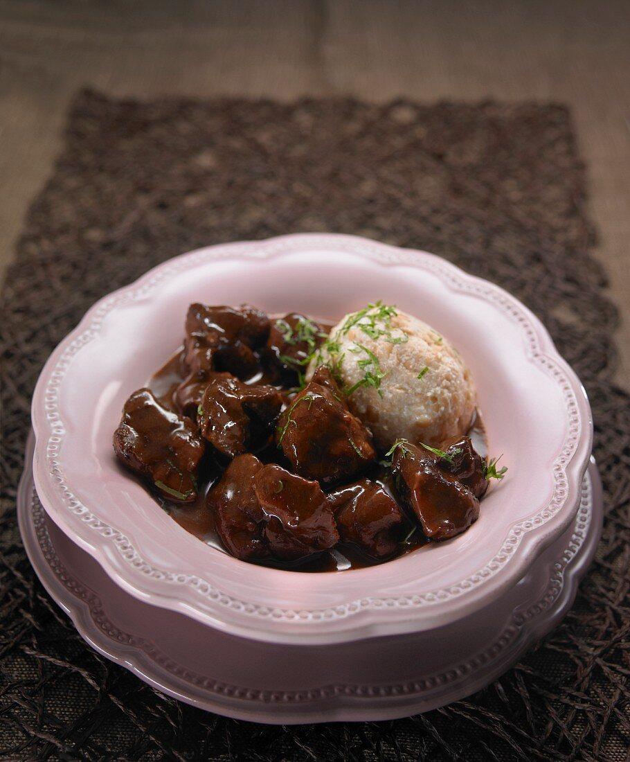 Boar goulash with bread dumplings