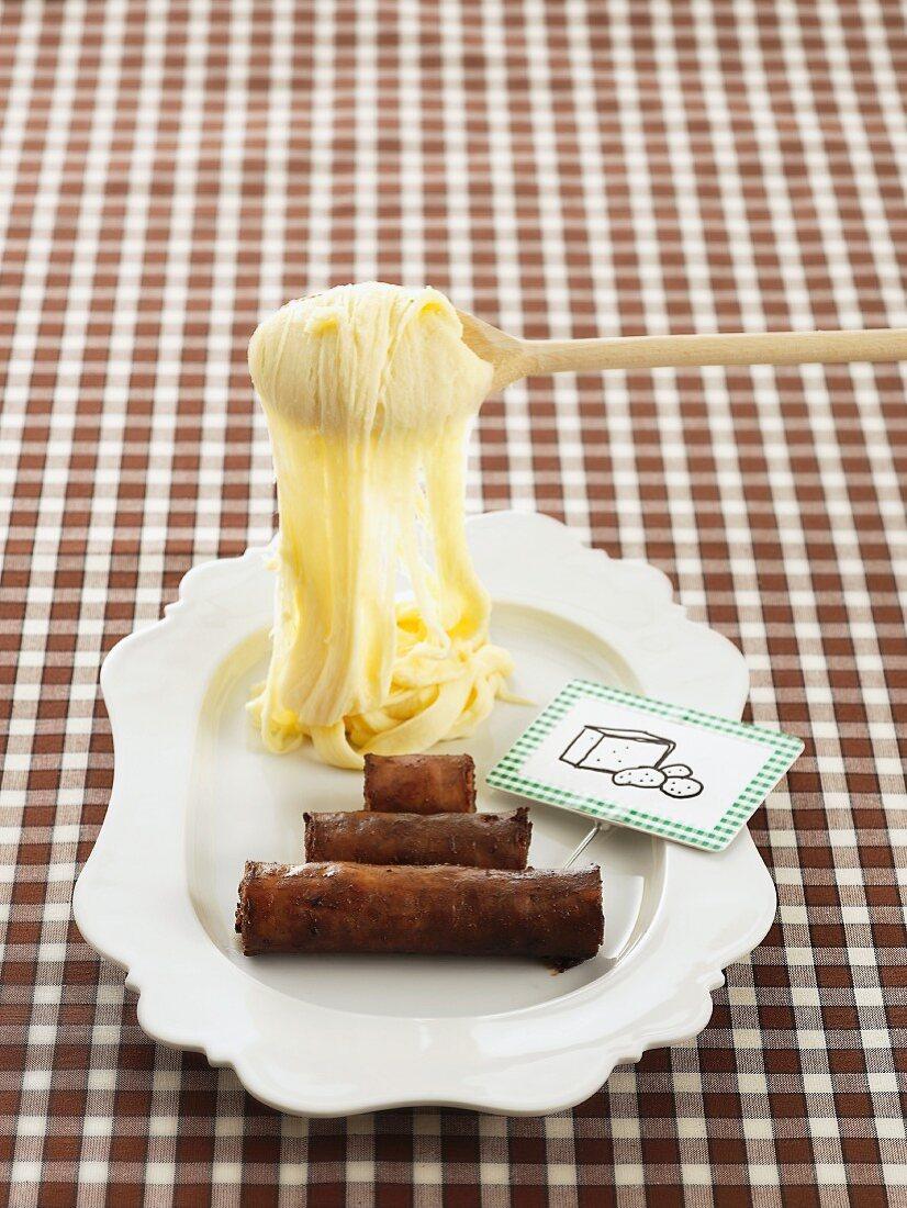 Aligot (cheese-potato puree, France)