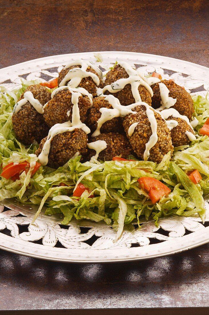 Kibbeh (grain-meat-meatballs on a salad plate)