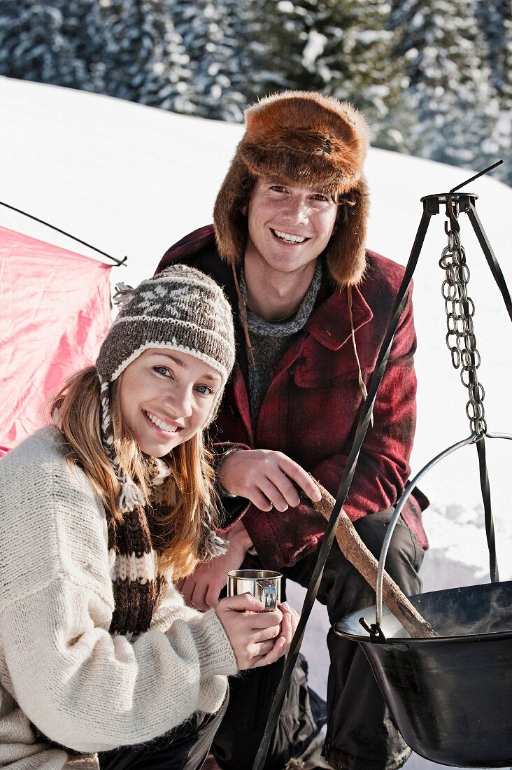 A couple camping in winter