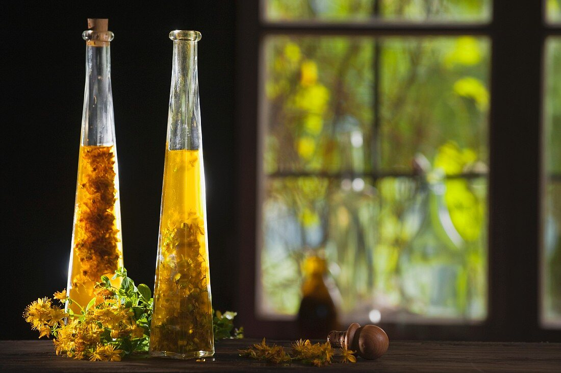 Two bottles of St. John's Wort oil on a window sill