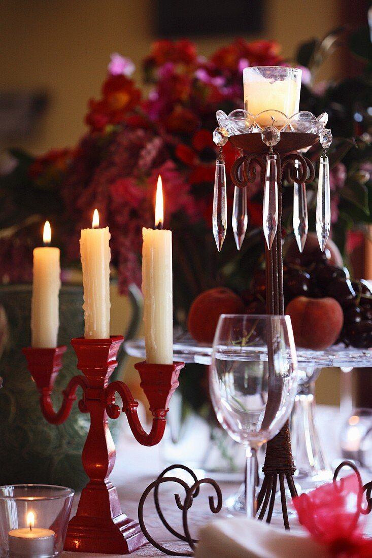 A Christmas table with various candle sticks
