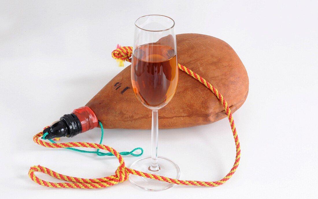 A glass of sherry and a bota de vino