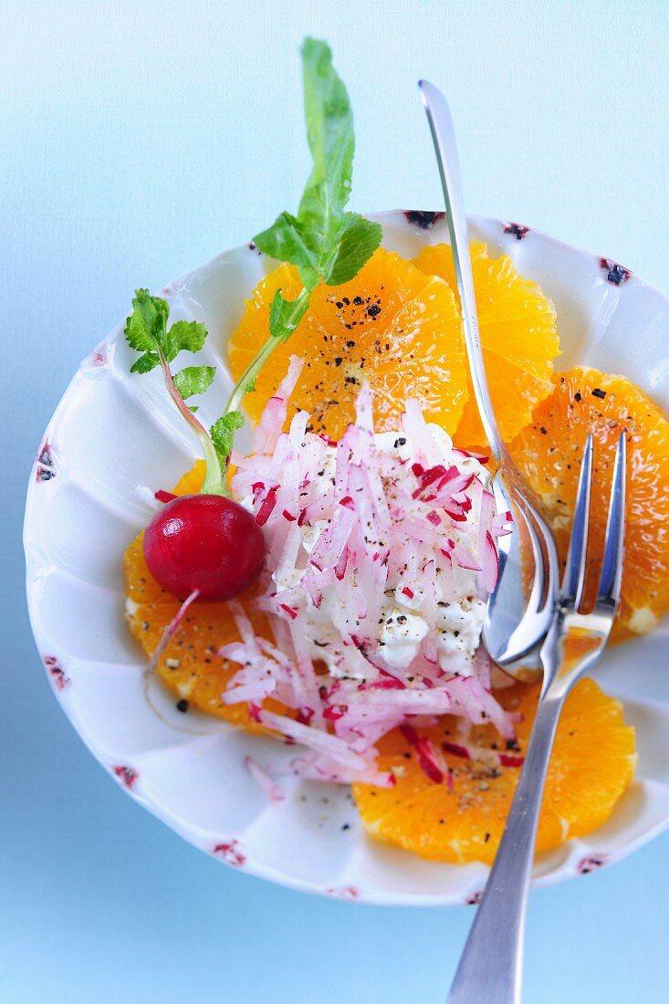 Radish salad on a bed of orange slices