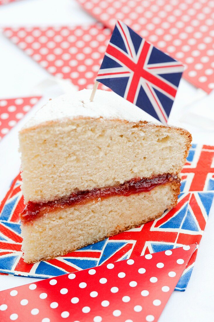 A slice of sponge cake decorated with a Union Jack