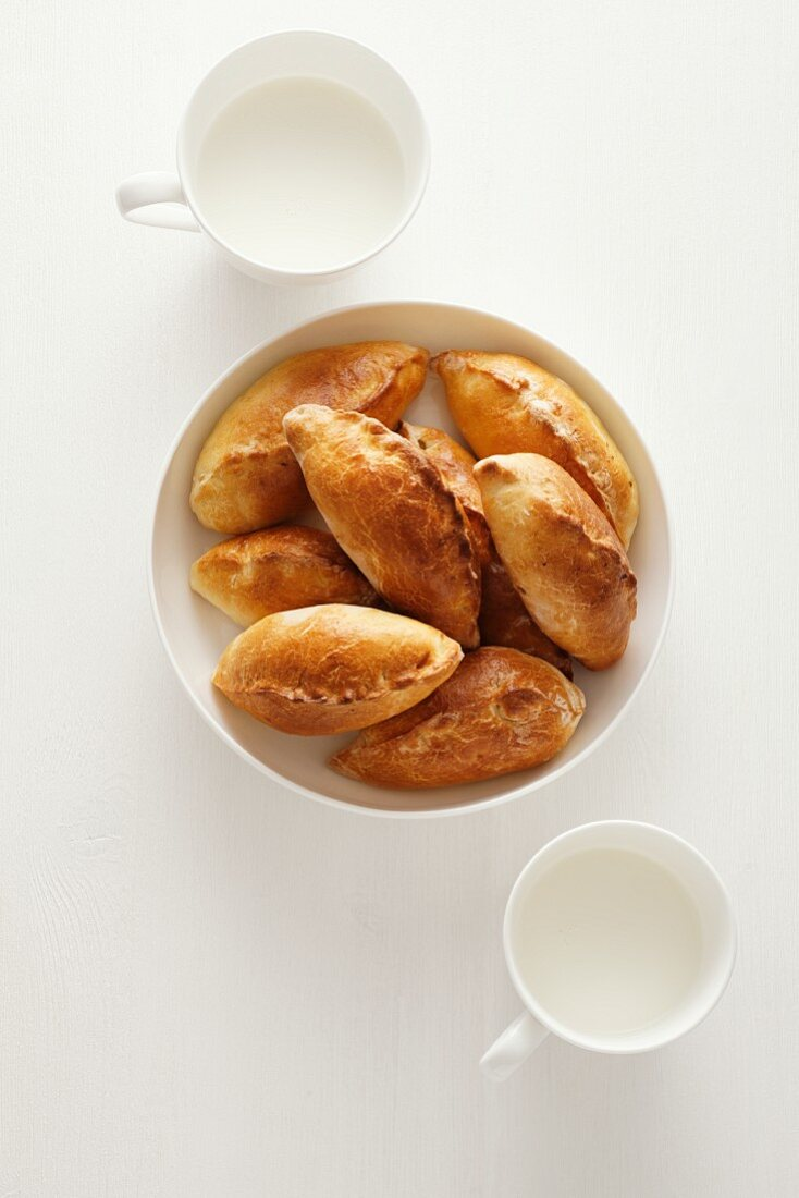 Bread rolls filled with rice and egg with cups of milk (Russia)