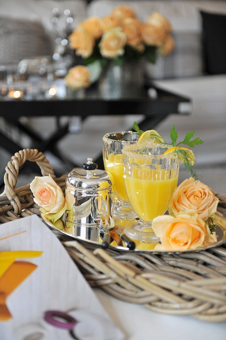 Gin and orange on a tray decorated with flowers