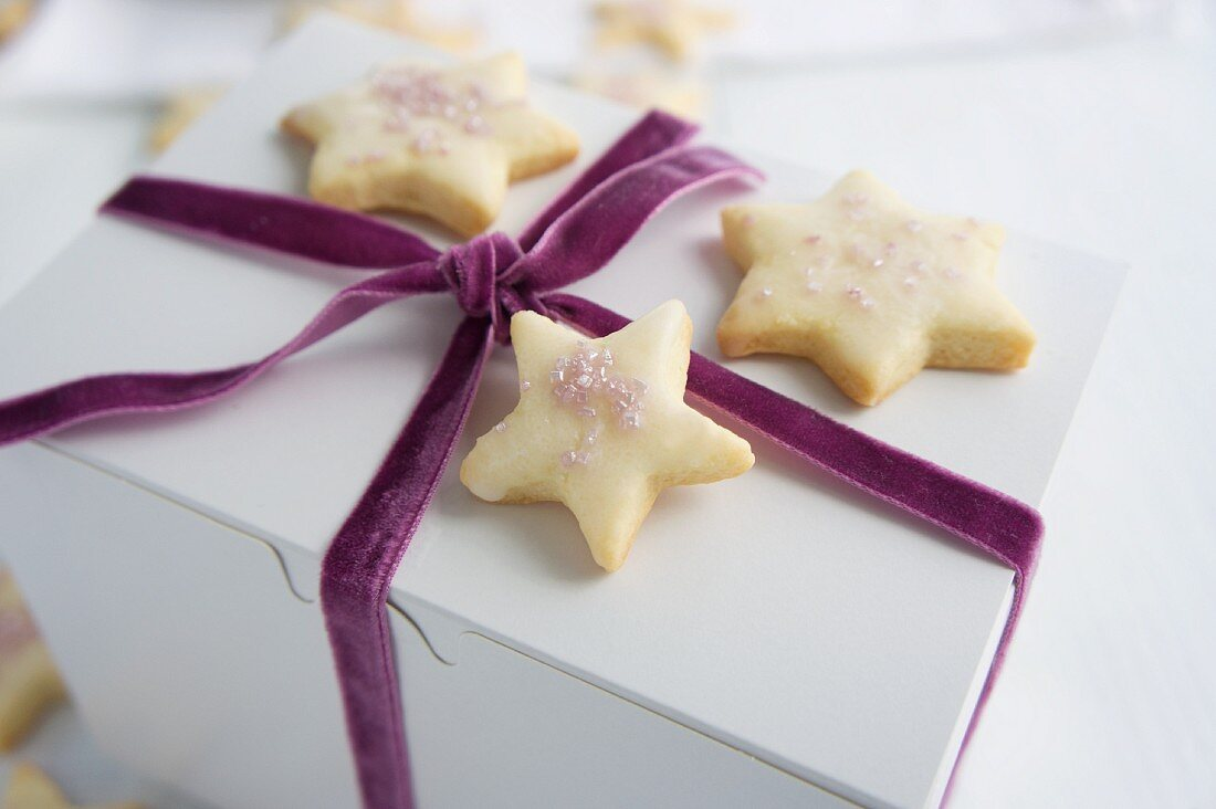 Star-shaped butter biscuits on a gift box tied with a velvet ribbon