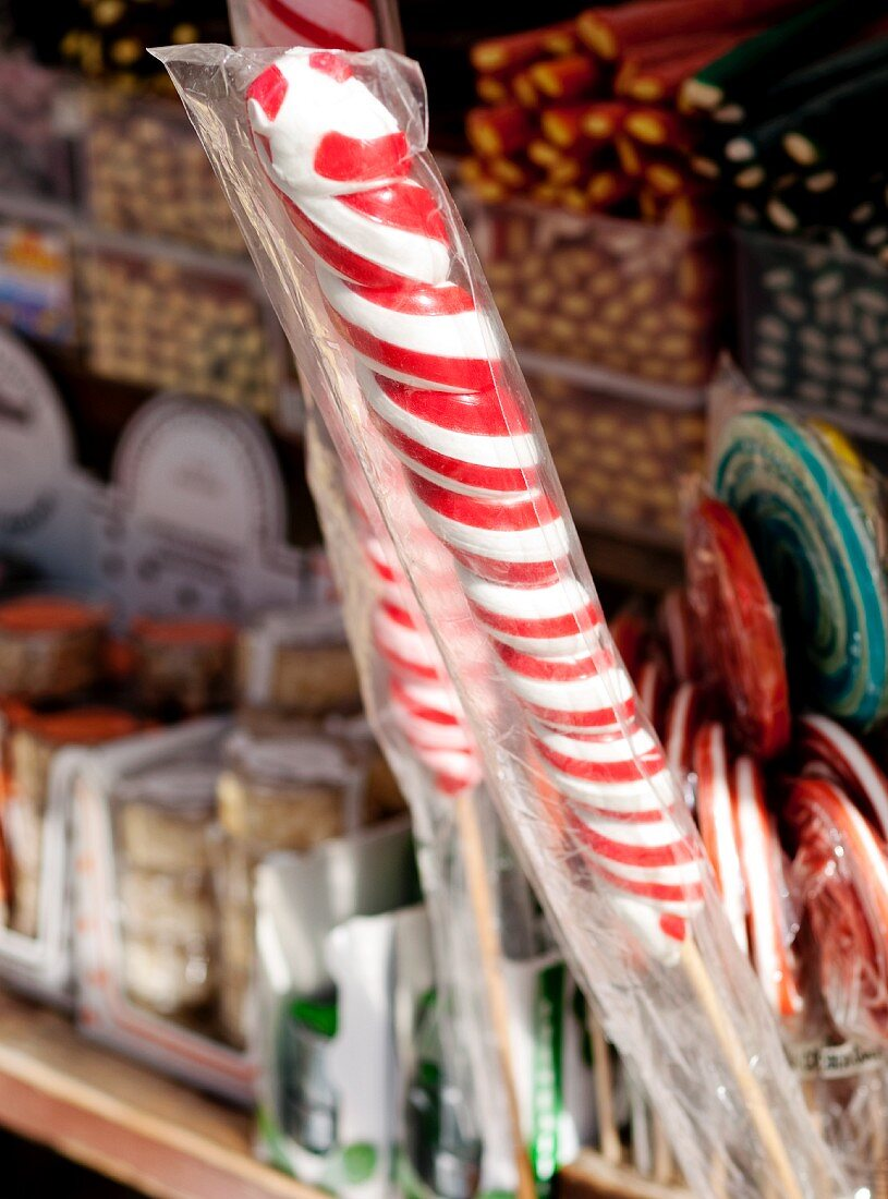 Red and White Swirled Candy Stick at a Candy Store in France