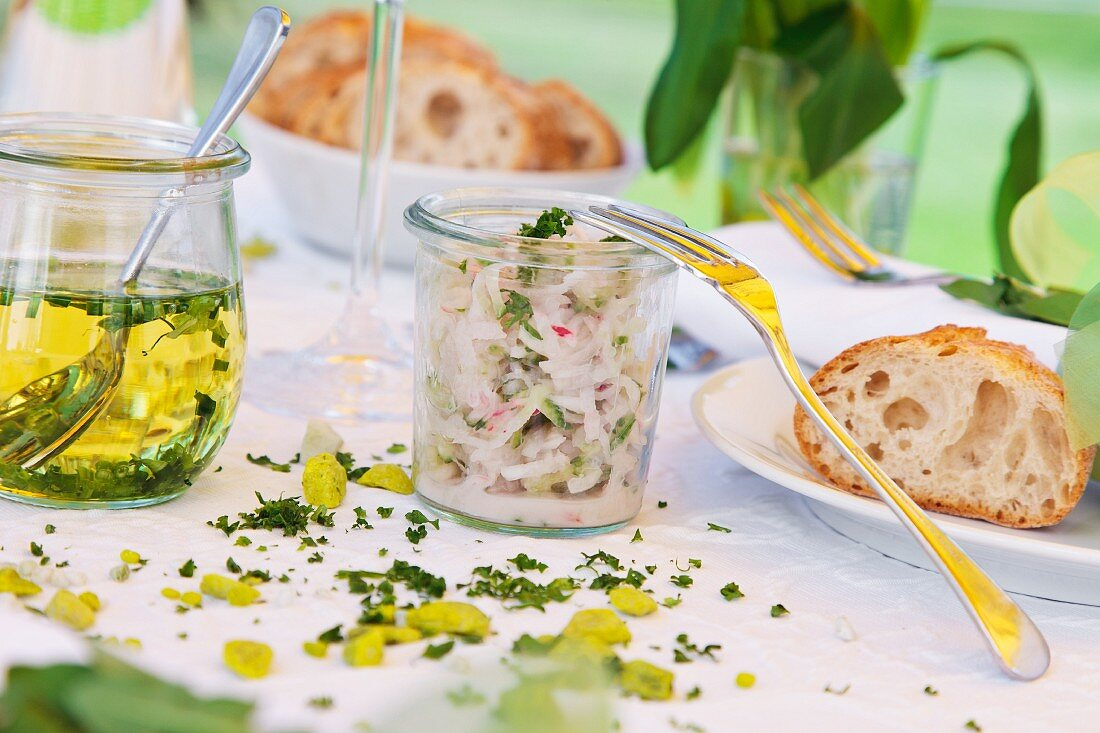 Radish salad and ramson oil in a jar