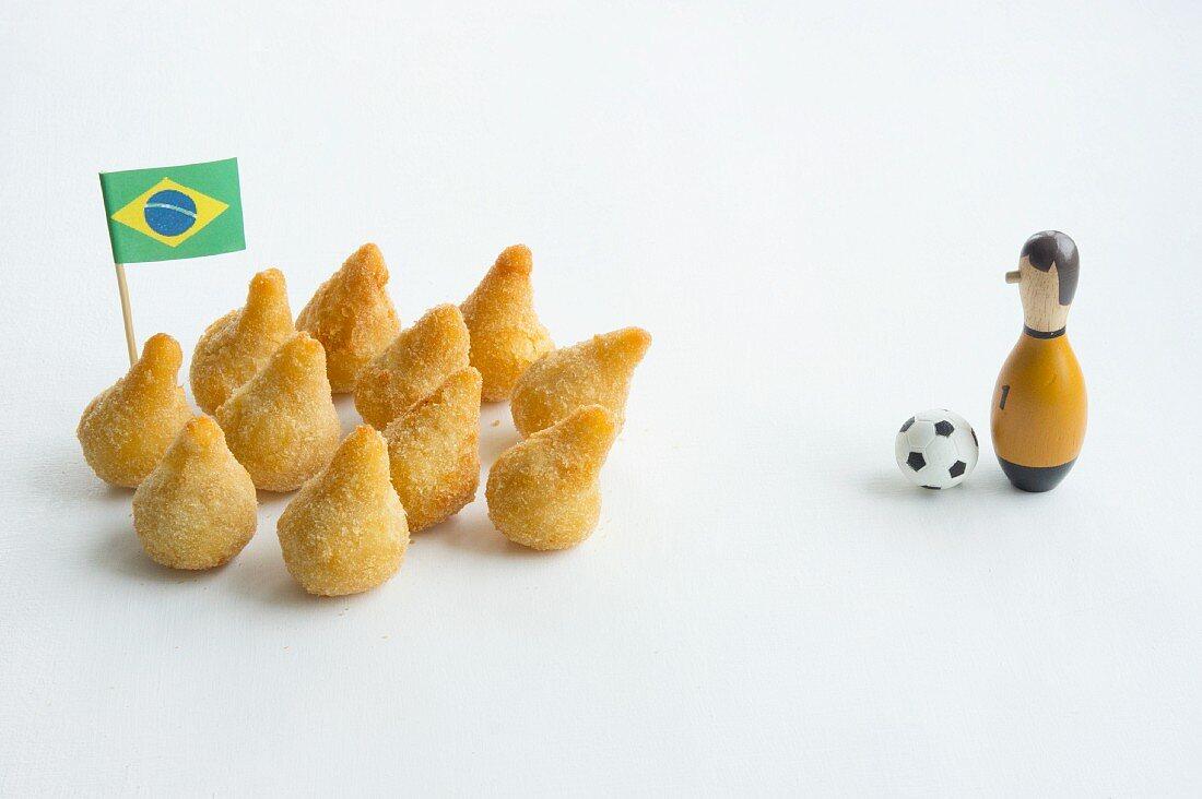 Salgadinhos with a Brazilian flag and football decorations