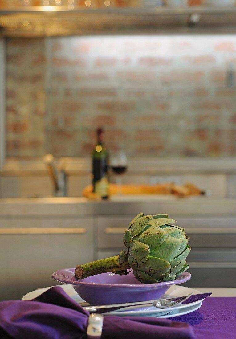 Artichoke on plate in kitchen