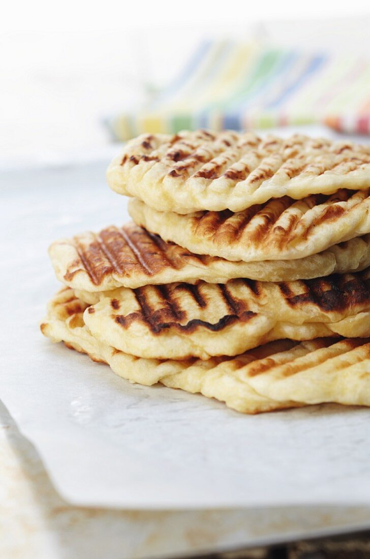 A stack of grilled flatbread