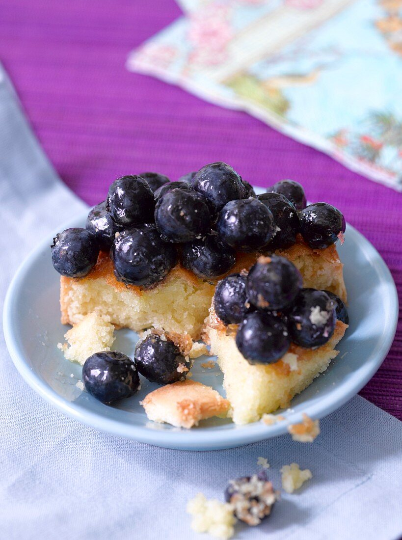 A blueberry tart with a bite taken out