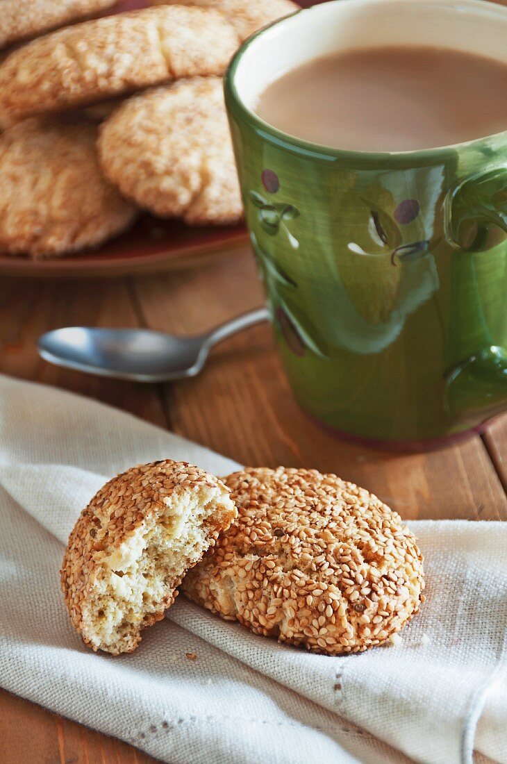 Regina Sesame Cookies on a Linen Napkin with a Cup of Coffee