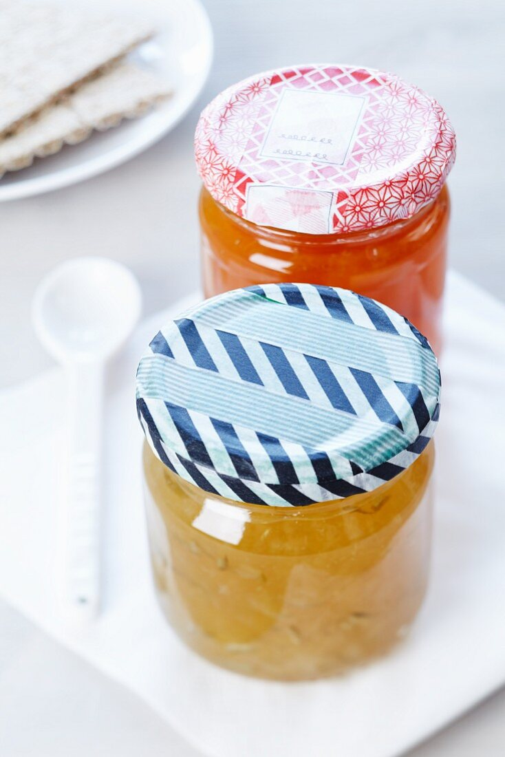 Jars of home-made jam with masking tape stuck on the lids