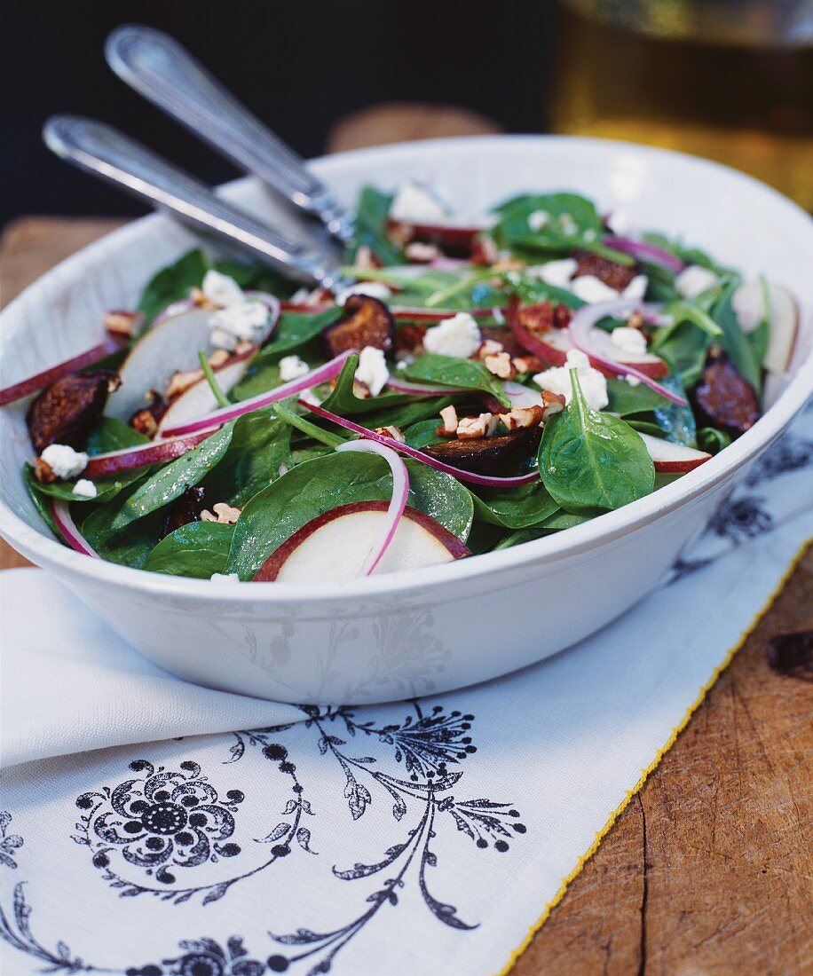 Spinach Salad with Red Anjou Pear, Red Onion and Dried Figs; In a Serving Bowl