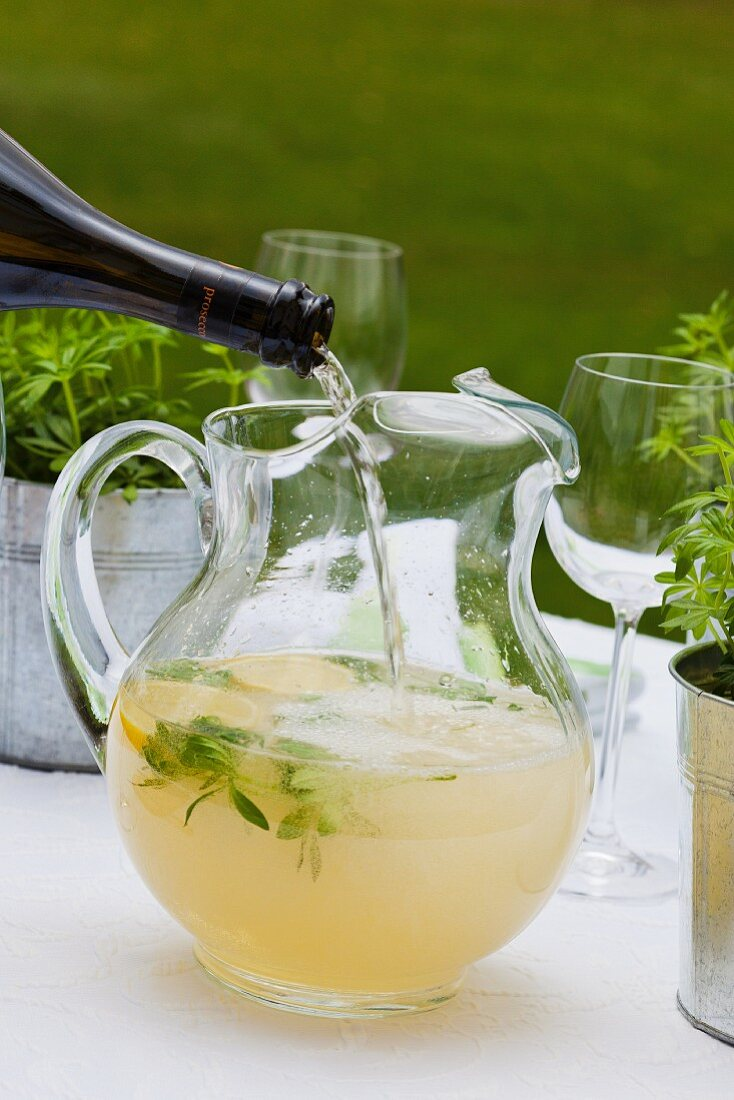 Woodruff punch being topped up with Prosecco