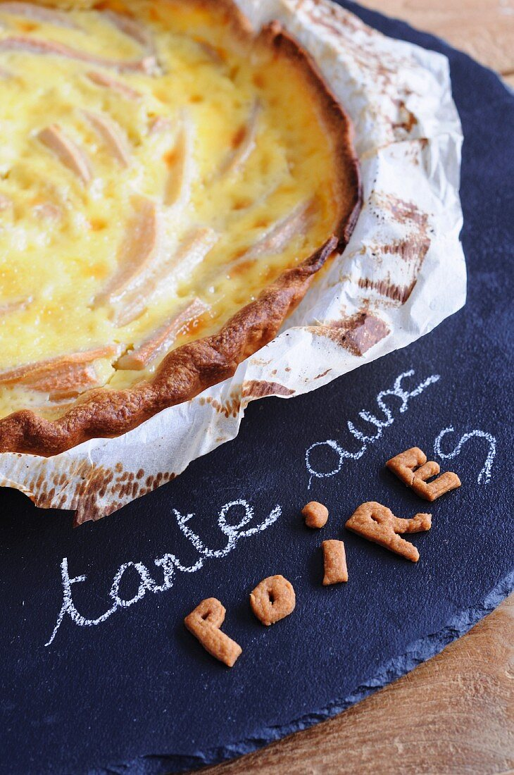 Pear tart with a cream and egg topping