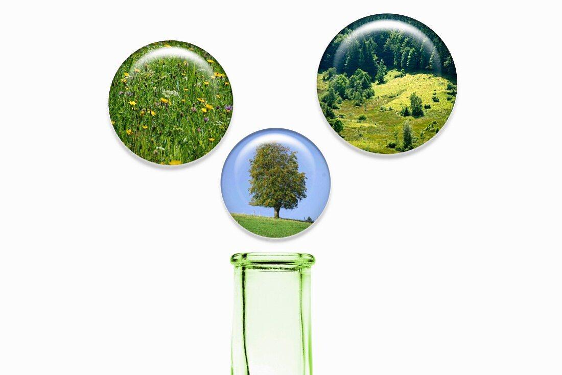 Landscape images in balls above a glass bottle