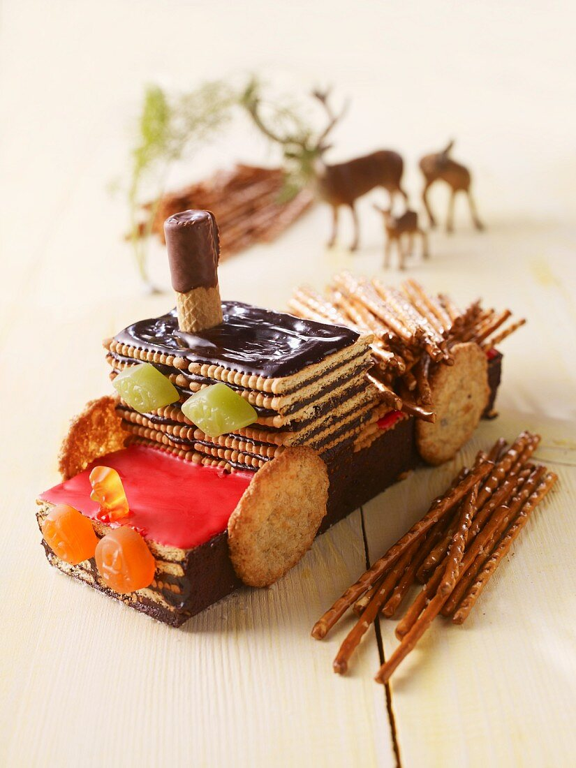 A chocolate biscuit cake shaped like a pick-up truck
