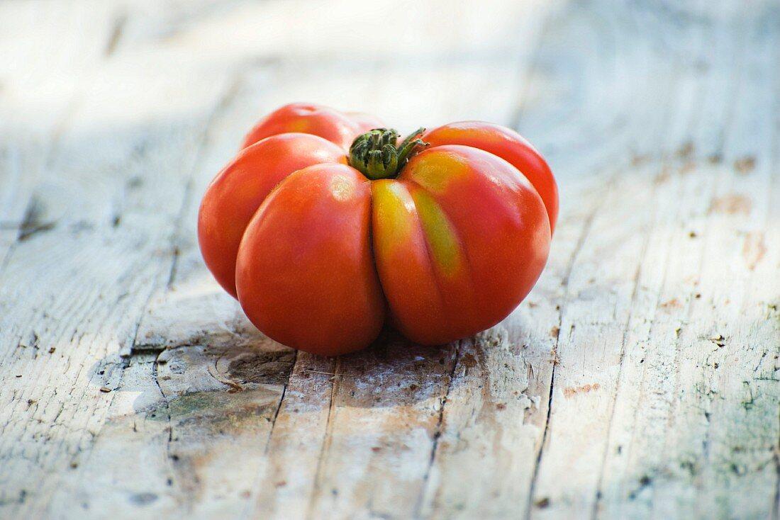 Heirloom tomato on wooden background