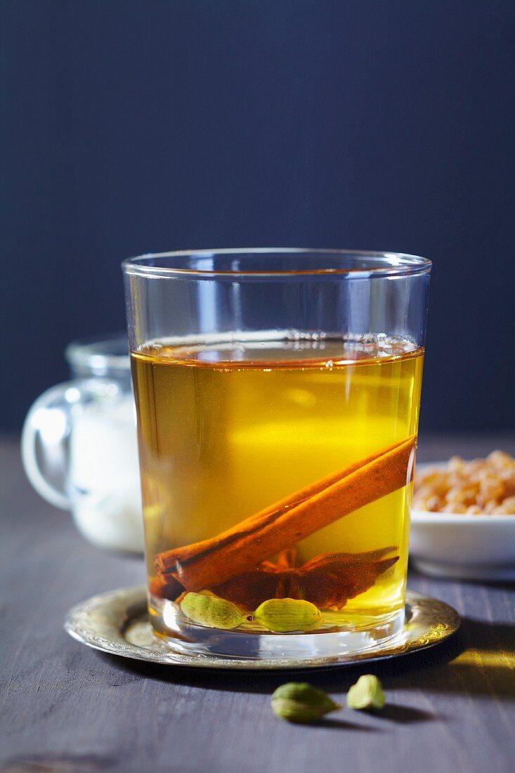 Arabic tea with cardamom, a cinnamon stick and star anise