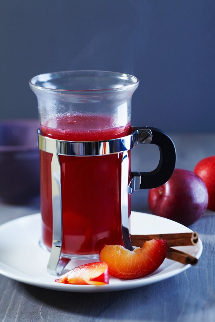 Plum punch with cinnamon sticks and plums