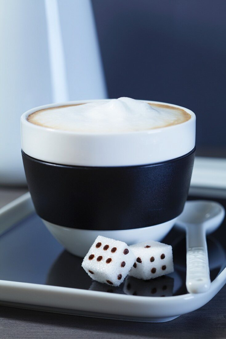 Cappuccino and dice-shaped sugar cubes