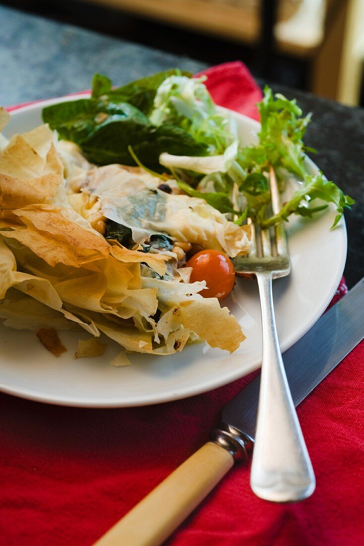 Goat's cheese and spinach pie with a side salad