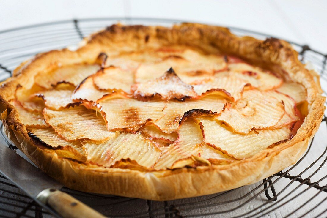 Nectarine and apple tart on a wire rack