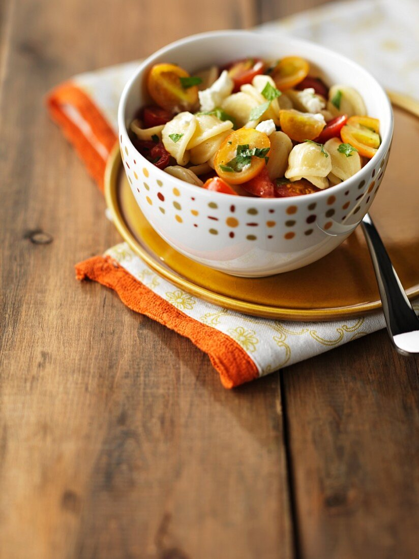 Orecchiette pasta with cherry tomatoes and goat's cheese